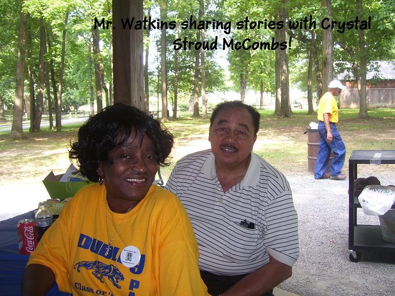 Mr.Watkins and Crystal McCombs sharing stories